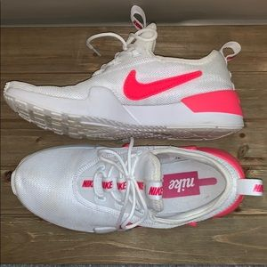 Hot pink and white Nike shoes